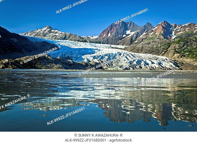 Scenic view of Riggs Glacier reflecting on the water of Muir Inlet, Glacier Bay National Park & Preserve, Southeast Alaska, Summer