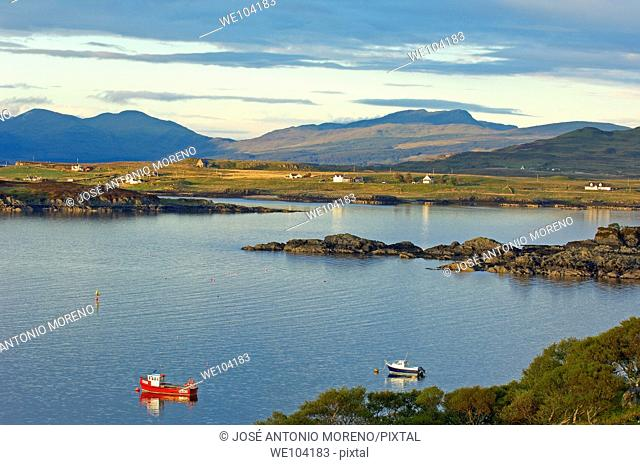 Boats at sunset in Loch Scridian, Mull, Inner Hebrides, Argyll and Bute, Scotland, United Kingdom, Europe