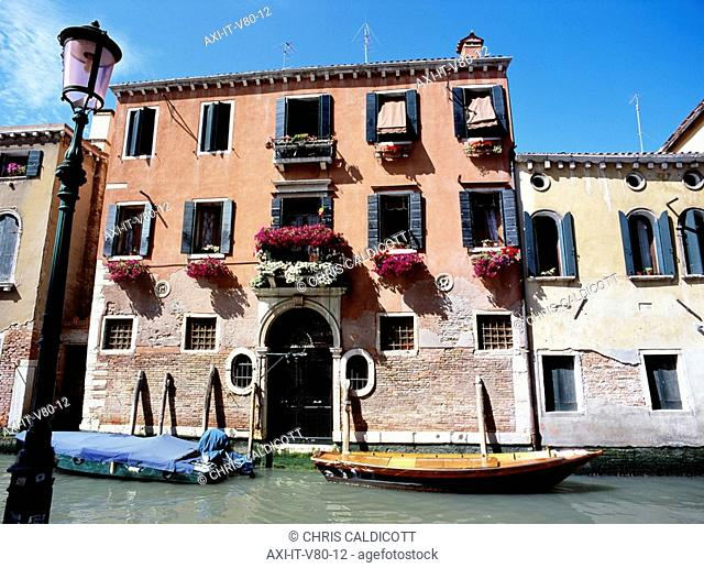 Traditional Venetian building along canal