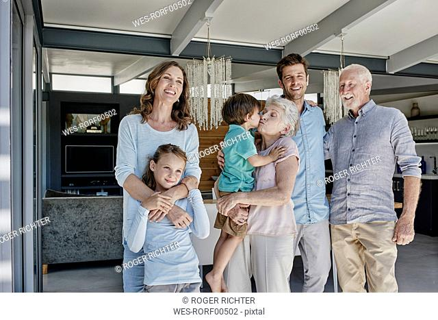 Multi generation family standing in family home
