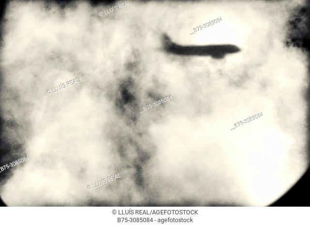 View of the shadow of aircraft from the window of a plane