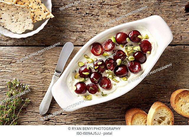 Goats cheese with sauteed cherries, pistachios and fresh thyme. Served with bread and flax seed crackers