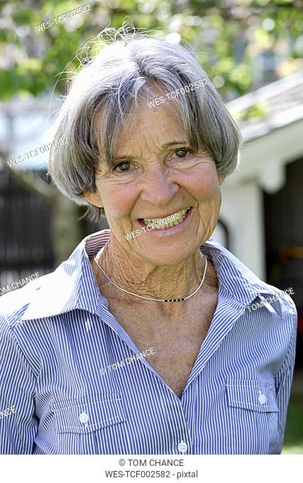 Germany, Bavaria, Senior woman smiling, portrait