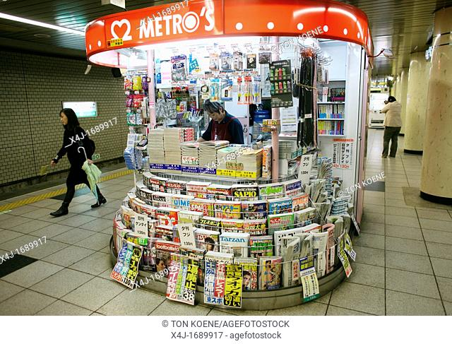 newspapers and magazines are sold at the kiosks at every metro station in Tokyo, japan
