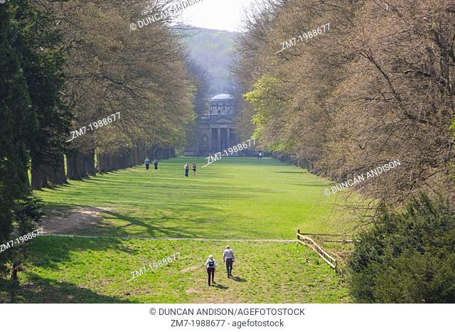 Visitors of Gibside Hall walking down the tree lined walk towards the Chapel. National Trust