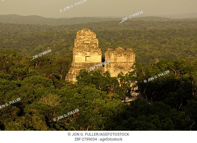 Sunset view of Temples I and II from Temple IV of Tikal National Park, Guatemala