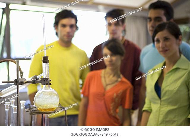 Beaker of chemicals over Bunsen burner