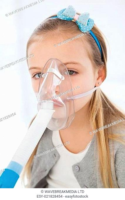 Sick girl with a mask over her mouth