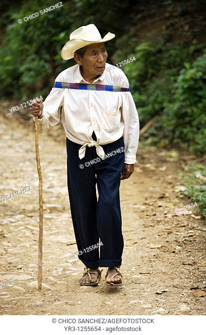 An elderly man walks in Yohualichan on the outskirts of Cuetzalan del Progreso, Mexico. Cuetzalan is a small picturesque market town nestled in the hills of...
