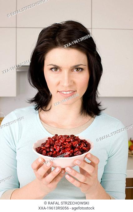 woman with dried cranberries