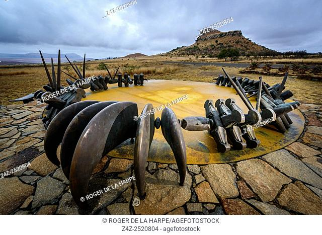 The Monument to the fallen Zulu Warriors at Isandlwana Battlefield. KwaZulu Natal Midlands. South Africa. The monument is in the form of a large bronze iziqu...
