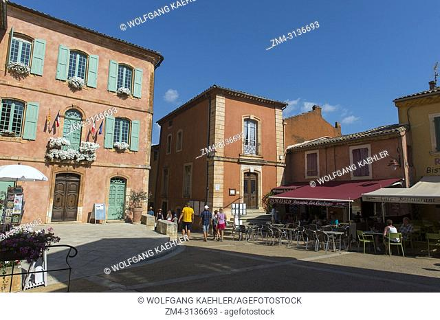 The main square with the town hall in the village of Roussillon in the Luberon, Provence-Alpes-Cote d Azur region in southeastern France