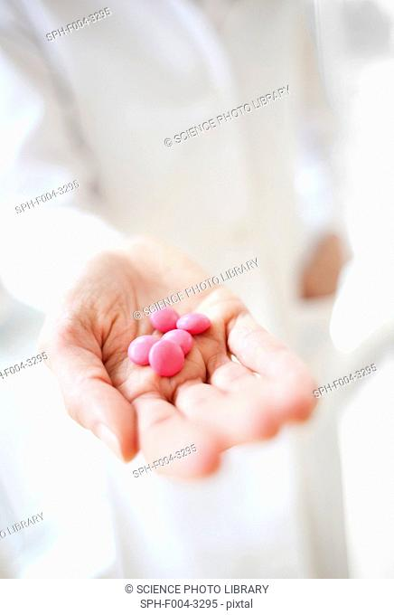 Pills in a doctor's hand