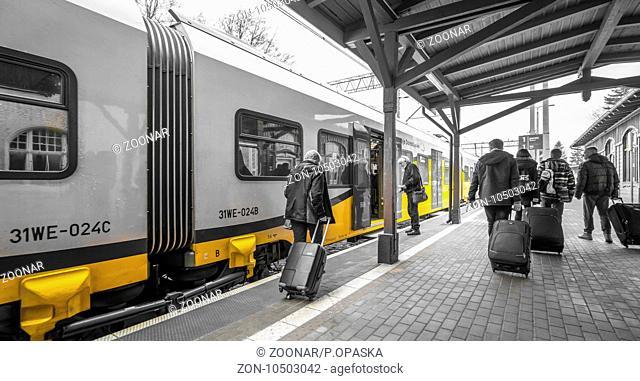 Tourists boarding the train