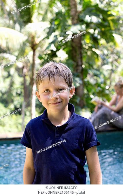 Smiling boy at sea