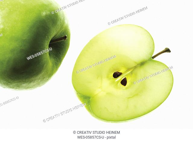 Sliced apple and whole fruit, close-up