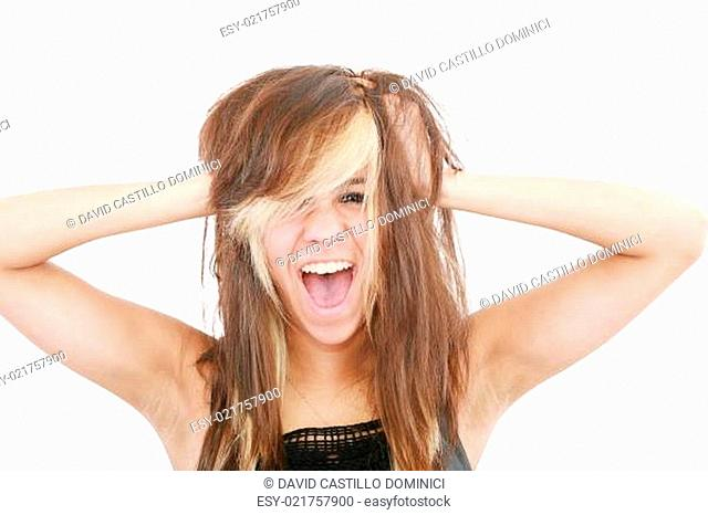 Stress. Woman stressed is going crazy pulling her hair in frustr