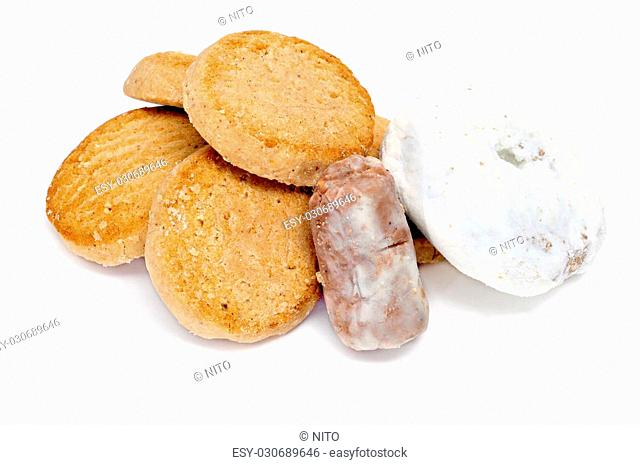 a pile of mantecados and polvorones, typical spanish sweets, on a white background