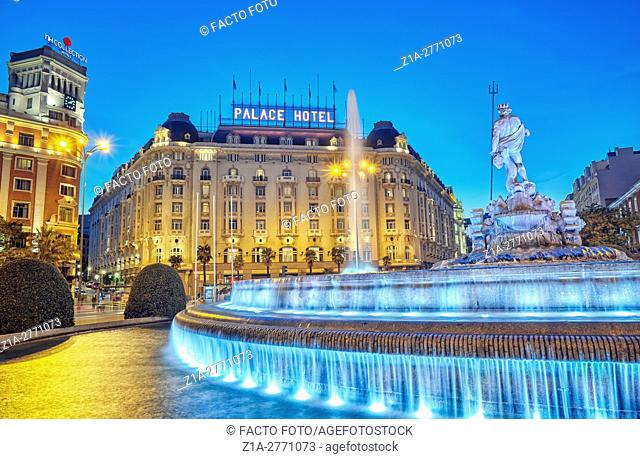 Neptune fountain and the Palace hotel, located at the Paseo del Prado boulevard. Madrid, Spain