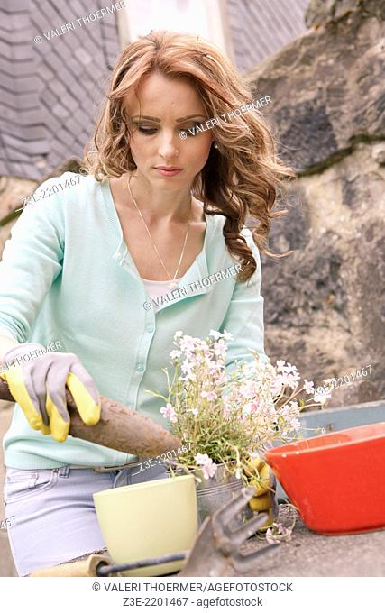 young woman working in the garden, Coburg, Germany