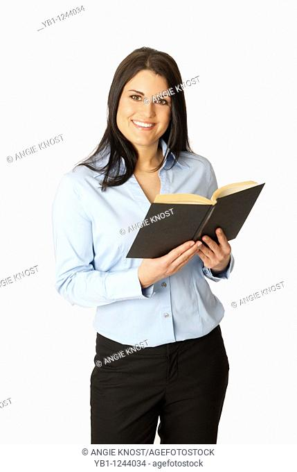 Attractive brunette woman holding a book with blank cover