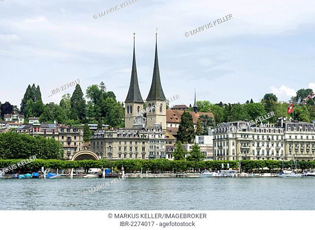 View of Hofkirche St. Leodegar church with the steeples and the historic district of Lucerne seen across Lake Lucerne, canton of Lucerne, Switzerland, Europe