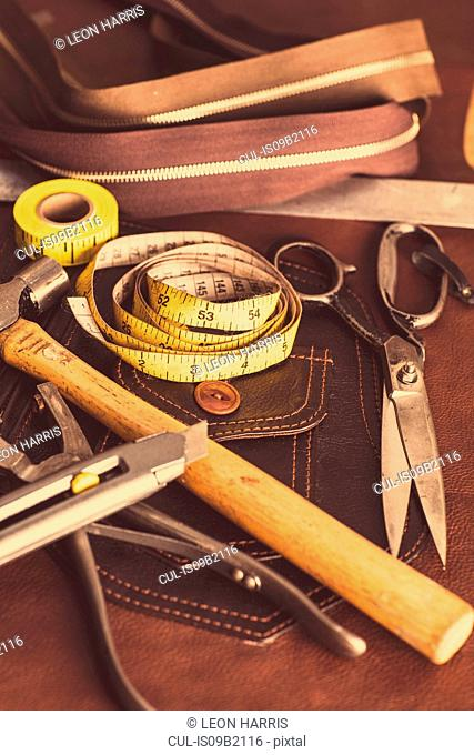 Still life of dressmaking equipment in leather jacket manufacturers, close-up