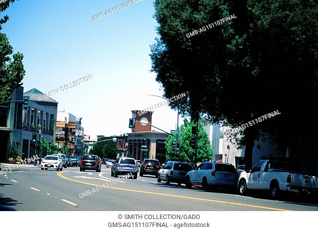 Cars drive down South Main Street towards Olympic Boulevard in the downtown portion of the San Francisco Bay Area town of Walnut Creek, California, June 21