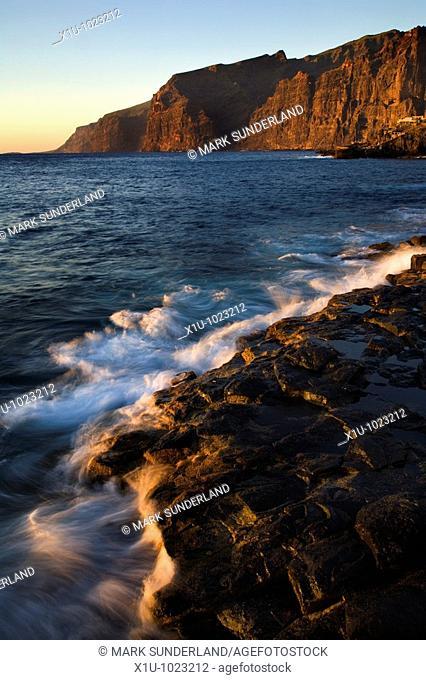 The Atlantic Crashes onto the Volcanic Shore near Los Gigantes Cliffs Tenerife Canary Islands Spain