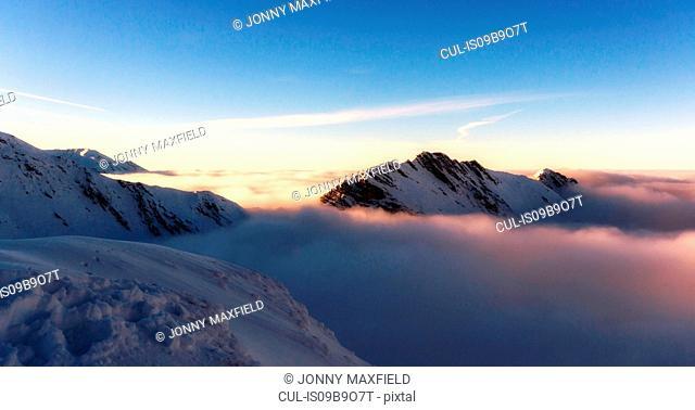 Scenic view of mountains in mist, Fagaras, Brasov, Romania, Europe