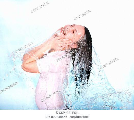 Girl in water splashing. Body care