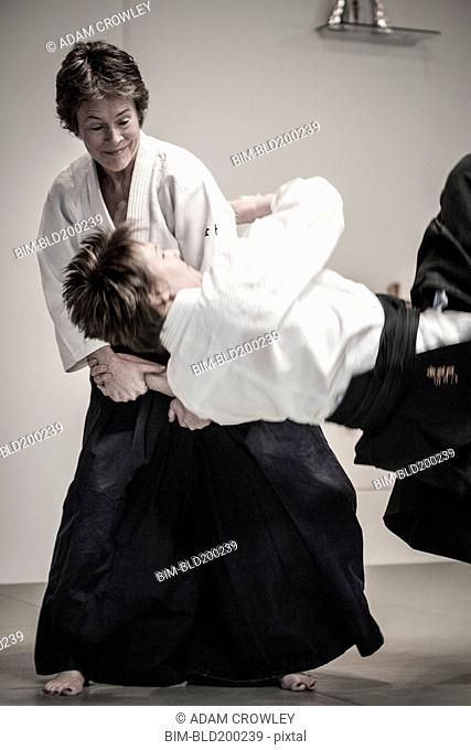 Caucasian people practicing martial arts