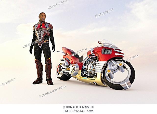 Smiling man standing near futuristic motorcycle