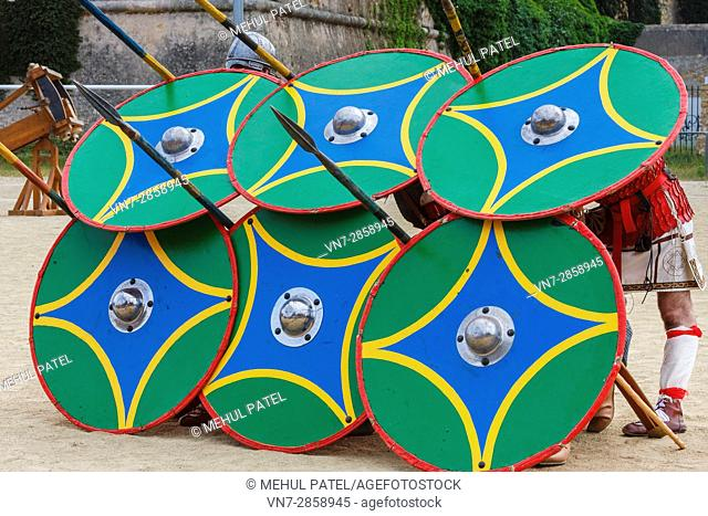 Roman soldiers with battle shields in defensive formation during the annual 'Tarraco Viva' festival held in Tarragona, Catalonia, Spain