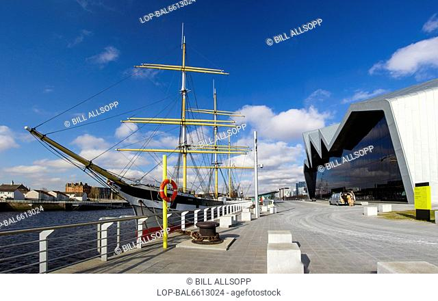 Scotland, Lowlands, Glasgow. Rear of Glasgow Riverside Museum and the tall ship Glenlee moored in the Clyde