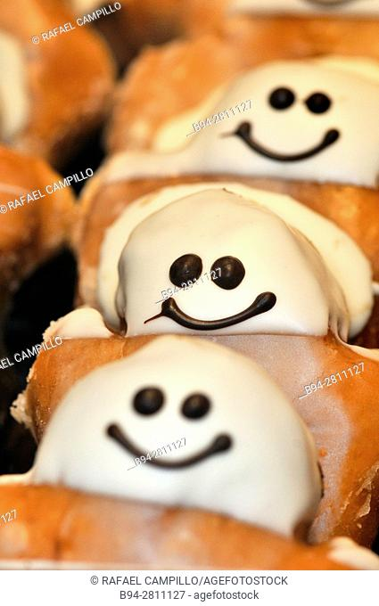 Pastries shaped like a smiling human being. Barcelona, Catalonia, Spain
