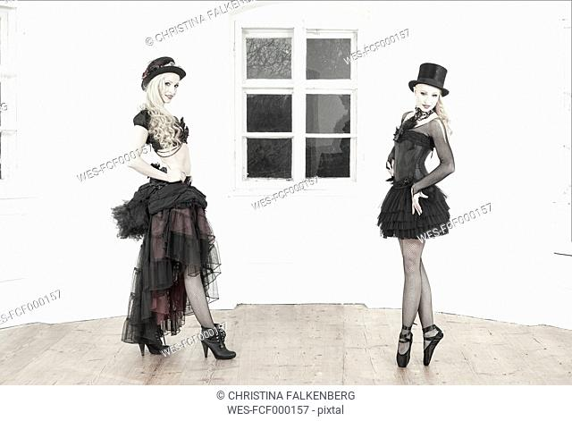 Two dancers in old-fashioned dresses