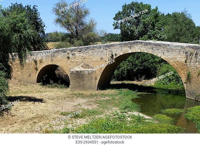 A medieval bridge built in 1575 in the town of St.Thibery, France