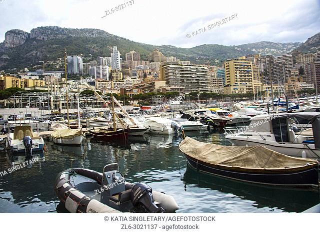 Majestic French harbor of the city of Monaco, in france. We can see the panoramic view of the ' Rocher' the mountains right from the old seaport with famous...