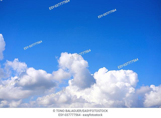 Blue sky white cumulus clouds background
