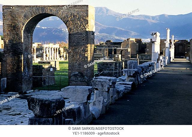 A perfectly preserved arch amongst old ruins, Pompeii, Italy