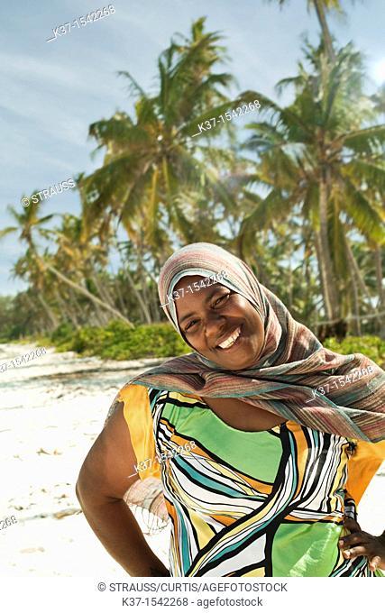 Local woman on beach on Zanzibar Island