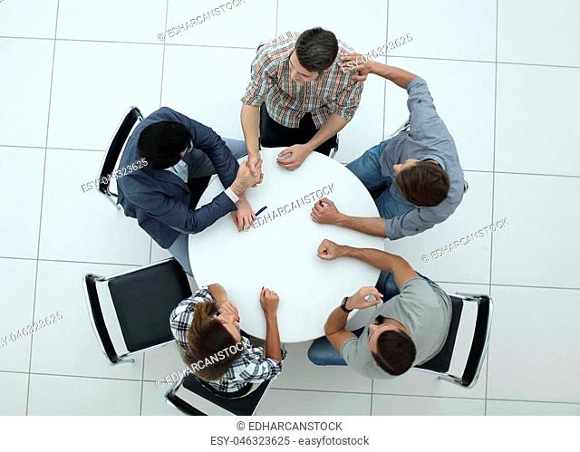 top view.creative business group sitting at the round table.photo with copy space