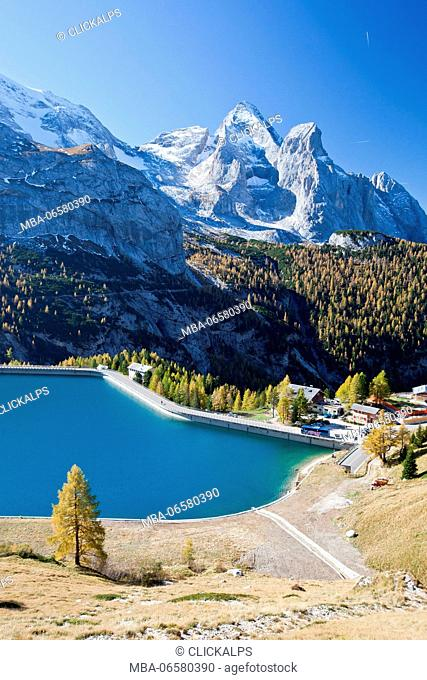 The Castiglioni Hut by the dam at Fedaia Pass in autumn, Dolomites, Italy