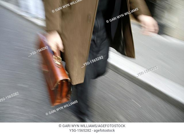 commuter with briefcase in town in rome italy