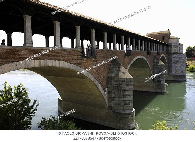 The Ponte Coperto (covered bridge), also known as the Ponte Vecchio (old bridge), a brick and stone arch bridge over the Ticino River in Pavia, Lombardy, Italy