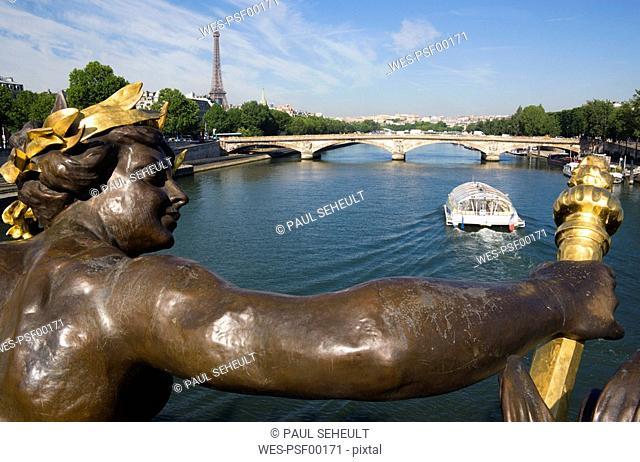 France, Paris, Seine, Pont Alexandre III, sculpture in foreground