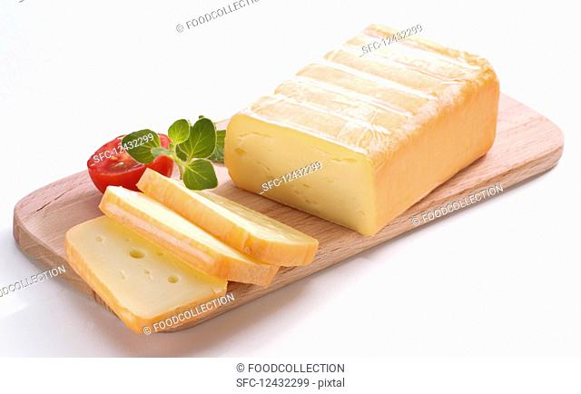 Limburger, sliced on a wooden board