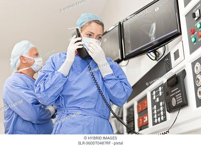 Doctor on phone in operating room