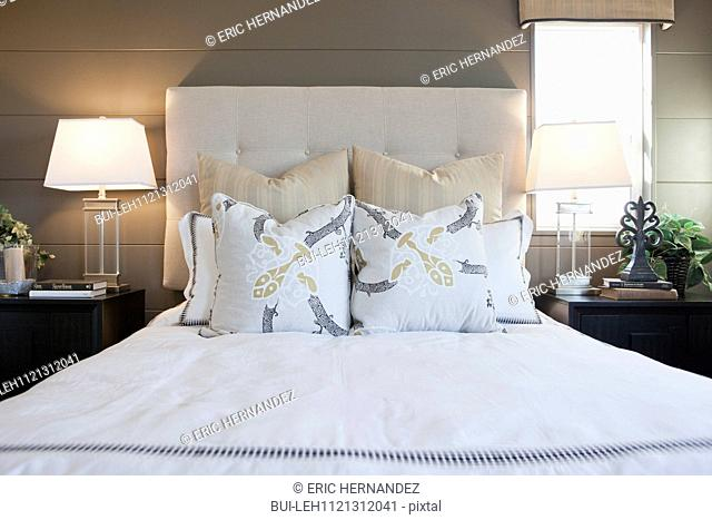 Pillows arrange on bed in contemporary bedroom; Murrieta; California; USA